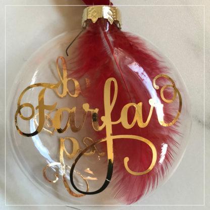Julekule I glass med rød fjær