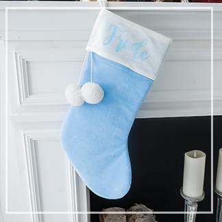 Produktbilde av julestrømpe på peishylle